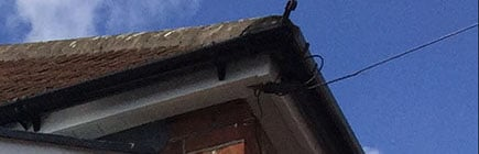 image of black guttering around the side of a house